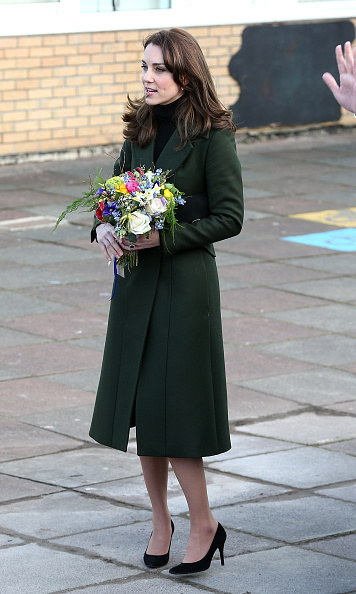 Kate was given a bouquet of flowers by waiting school children as she arrived at St. Catherine's Primary School, in the Scottish capital.