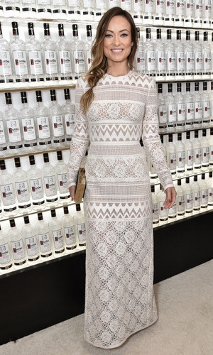 February 25: Olivia Wilde blended into a wall of Ketel One vodka bottles at the 3rd Annual Unite4: Humanity Gala, where she was recognized for her commitment to philanthropy.