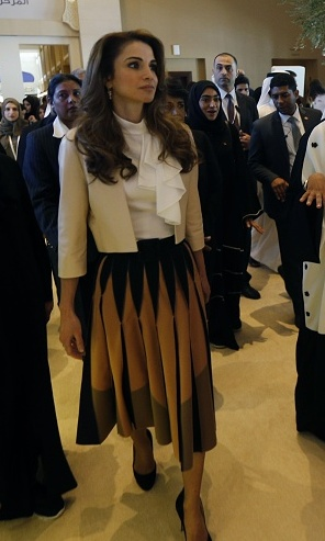 Queen Rania of Jordan opted for a ruffled blouse and pleated print skirt for the opening day of the Global Women's Forum in Dubai.