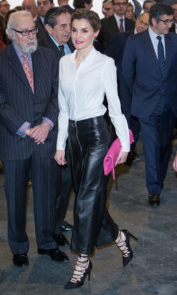 Daring Queen Letizia wore wide-legged leather trousers and strappy stilettos for the opening of the ARCO 2016 modern art exhibition in Madrid. (Matching her lipstick to her hot pink clutch was a nice touch!)
