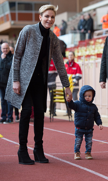Mom-on-the-go Princess Charlene of Monaco chose easy knits and wedge boots when she took 1-year-old son Prince Jacques to a weekend rugby game.