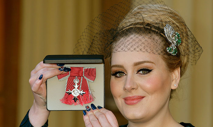 True to form, Adele opted for a vintage inspired look when she attended Buckingham Palace to receive an MBE from Prince Charles. The songstress accessorized her outfit with a chic veiled headband.
