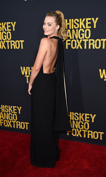 March 1: Back at it! Margot Robbie showed off her toned back in a stunning black dress during the premiere of <i>Whiskey, Tango, Foxtrot</i> in NYC. 