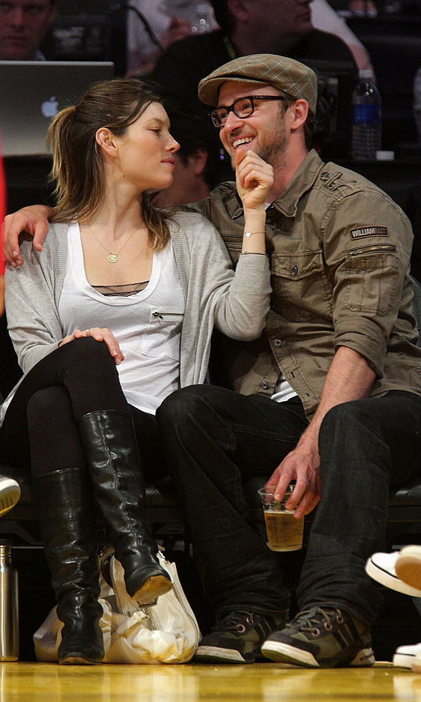 How could you not love that face?! Jessica held close to Justin at a Lakers game in 2009.