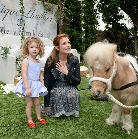 March 5: Joanna Garcia Swisher and her adorable daughter Emerson checked out the mini pony at the Monique Lhuillier for Pottery Barn Kids Collection launch at Hollywood's Lombardi House.