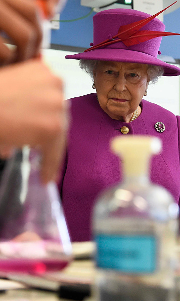 It was back to school for Queen Elizabeth. Great Britain's longest-reigning monarch viewed a chemistry lesson during a Queen's Trust visit to Lister Community School in London.