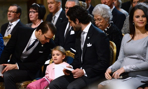 After the birth of brother Prince Oscar, big sister Princess Estelle has the attention of her dad, Prince Daniel and uncle Prince Carl Philip during a thanksgiving service held at the Stockholm Royal Palace church.