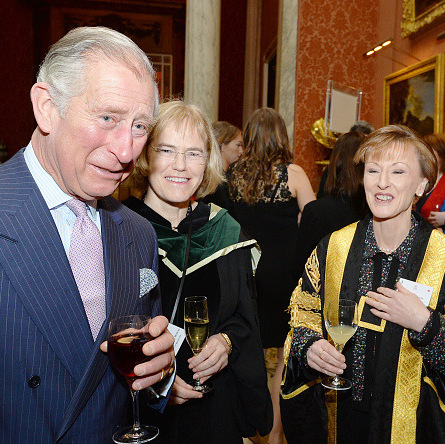 Cheers! Prince Charles chatted with University of Bradford staff members following a presentation of The Queen's Anniversary Prizes for Higher and Further Education at Buckingham Palace.