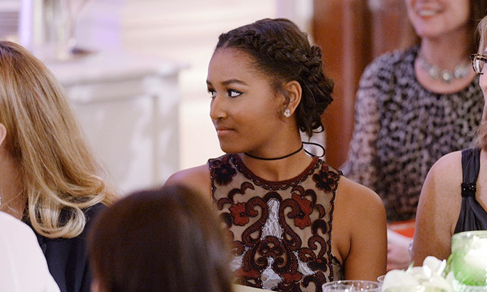 "Fouteen-year-old Sasha also looked beautiful wearing her hair up in a sophisticated braided updo. Talking about Barack's daughters Justin said,""I admire you very much, both of you, for your extraordinary strength and your grace."" 