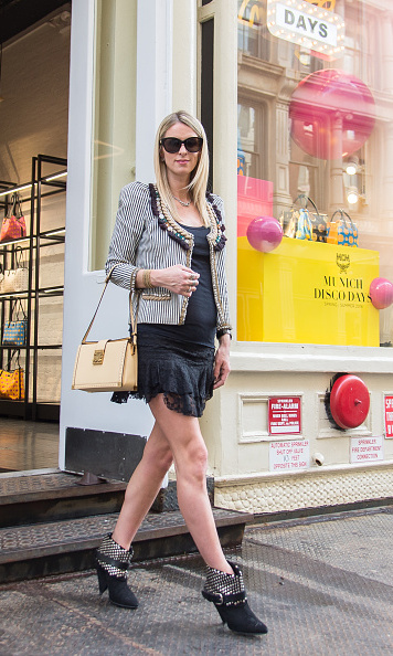 Showing off her stunning legs and baby bump in an edgy ensemble at MCM in Soho. 