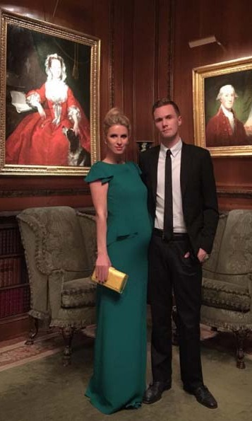 In this elegant Carolina Herrera gown, Nicky shows off her maternity style and her bump during a night out with her brother Conrad.