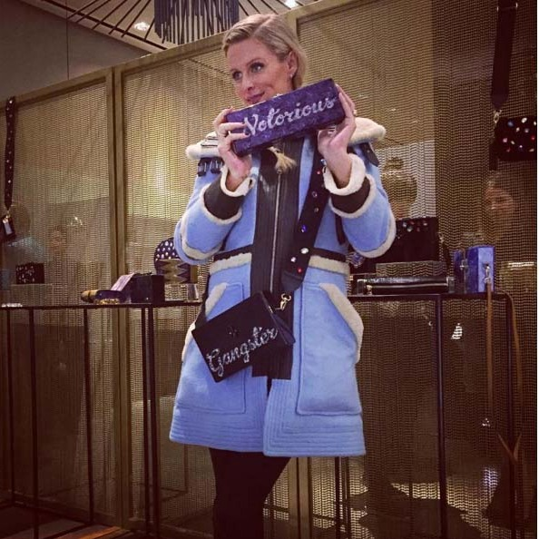 Bundling up her bump with some fun accessories. 