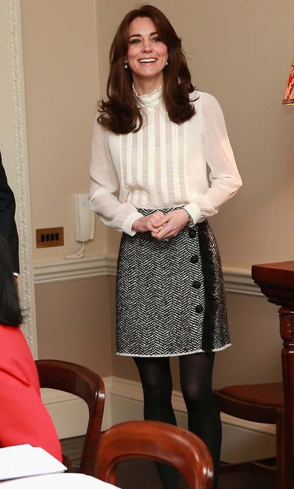 This office-ready look was for the day the Duchess became editor-for-a-day of the Huffington Post UK. She's wearing the vintage-inspired $170 Vinnie blouse from Reiss and a black-and-white wrap skirt from Dolce & Gabbana.