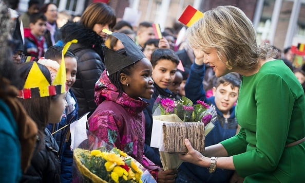 Queen Mathilde of Belgium received a royal welcome in Brussels while at the Victor Horta school Saint-Gilles during the presentation of an educational game about finances.