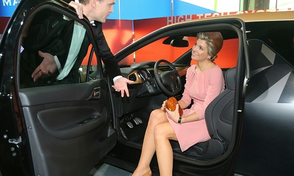 Queen Maxima of the Netherlands gave her feet a rest at the City of Fashion and Design during her state visit to France with husband King Willem-Alexander.