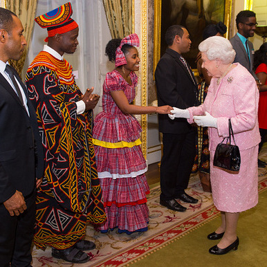 Queen Elizabeth was pretty in pink meeting with Africa Regional Winner of the Commonwealth Youth Awards Achaleke Christian Leke and Caribbean Regional Winner Shamoy Hajare at the annual Commonwealth Day reception.