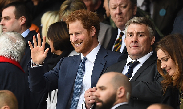 Hello, it's Harry! The Prince gave a friendly wave with RFU President Jason Leonard during the RBS Six Nations match between England and Wales.