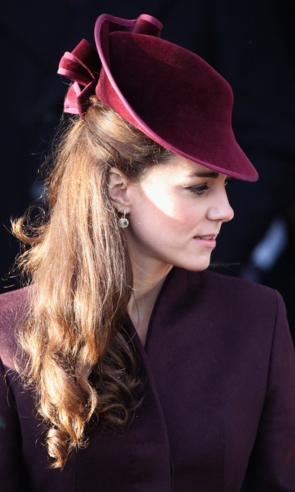 Kate's mulberry-colored, Jane Corbett-designed headpiece stole headlines around the world after she sported the couture creation for her first official Royal Christmas Church Service in 2011.