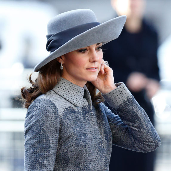 The Duchess of Cambridge looked stunning in a $3,500 Erdem coat and topped off the look with a matching wide-brimmed hat by John Boyd, a 90-year-old milliner who was known for designing for Kate's late mother-in-law Princess Diana.
