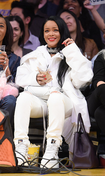 <i>Work</i> it girl! Rihanna made quite the statement in an astronaut-esque ensemble as she watched the Golden State Warriors play against the Los Angeles Lakers.