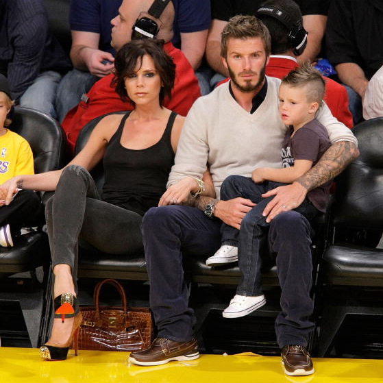 Victoria Beckham was just one of the guys — in Christian Louboutin high heels – at a Lakers game with husband David Beckham and son Cruz.