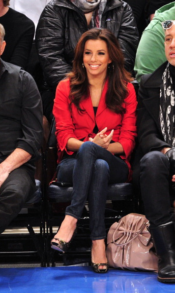 Eva Longoria was red hot in a bold-colored blazer, jeans and pumps, while sitting courtside at a Dallas Mavericks vs New York Knicks game.