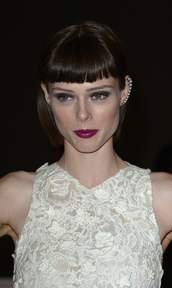 Want something mysterious and dramatic? Follow Coco Rocha's lead and opt for blunt bangs with an ultra-sleek straight bob.