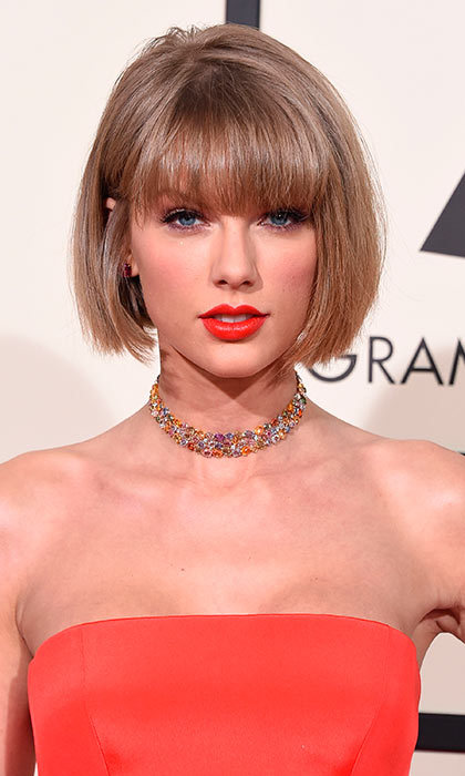Taylor Swift brought the Grammys red carpet to a standstill when she stepped out with a dramatic new Anna Wintour-style bob and bangs. What a statement look!