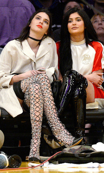 These boots are made for <i>balling</i>. Kendall and Kylie Jenner made a bold, fashion statement in over-the-knee boots at a Lakers vs. Sacramento Kings game.