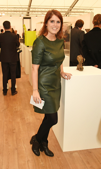 Stylish in a green, leather mini at a Frieze Art Fair preview in 2015.