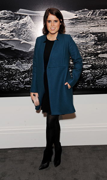 She added a pop of color to her black ensemble with a blue coat at a private view of 'Monuments' by Fabien Baron.
