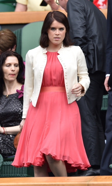 Pretty in pink. Eugenie served major style points in a flowy dress and jacket during the 2014 Wimbledon Championships.