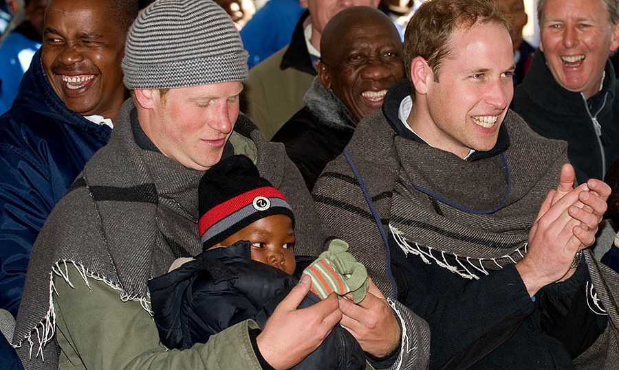 William and Harry got bundled up, along with a little new friend, during their visit to Lesotho.
