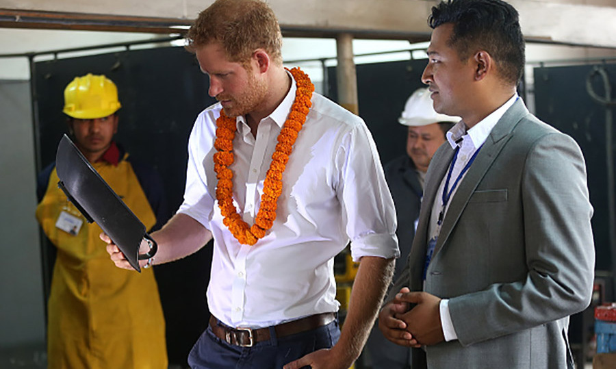 Prince Harry looked at plans during his visit to the Samo Thimi Technical School. 