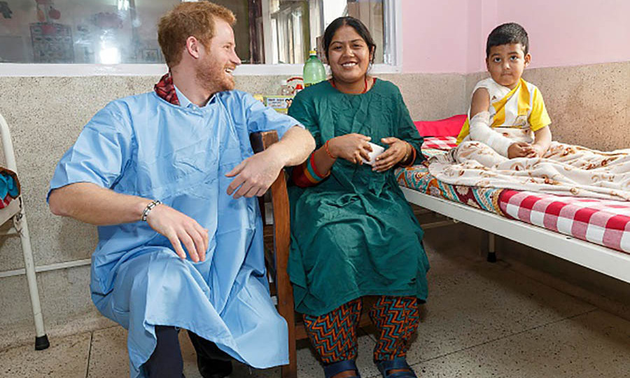 Prince Harry laughed with Anju, mother of four-year-old burn victim Biplov Puri during his visit to the Kanti Children's Hospital. 