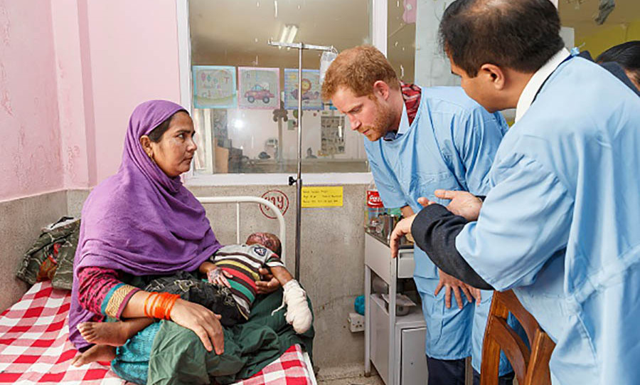 Prince Harry met three-year-old burn victim Gurfan Ansa and his aunt Raja Khatun during a visit to the Kanti Children's Hospital. 