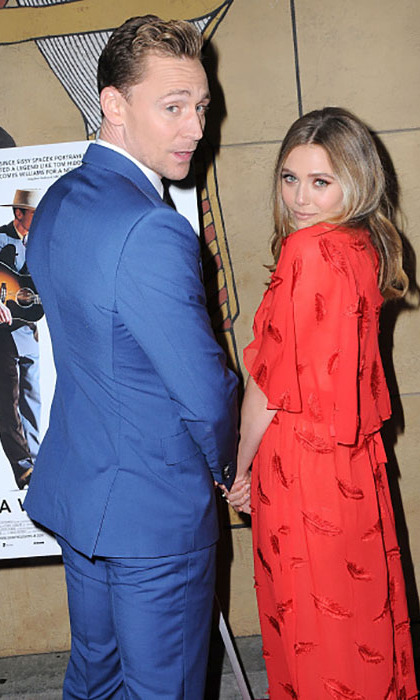 March 22: Good times! Tom Hiddleston and actress Elizabeth Olsen had some fun during the <i>I Saw the Light</i> premiere in Hollywood.