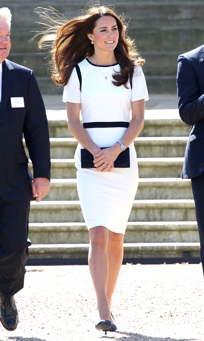 Looking classic yet elegant in this black-and-white Jaeger ensemble, Kate visited the National Maritime Museum in London, England. The duchess anchored the polished look with simple Alexander McQueen navy suede heels. 
