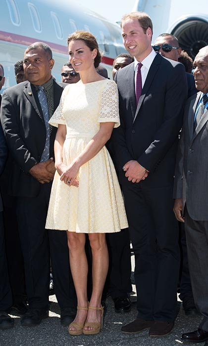 Continuing on with the cream-colored trend, Kate looked super chic in this knee-length dress, which she complemented with Stuart Weitzman wedges and an elegant updo. 