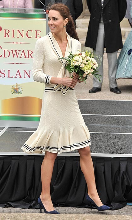Kate won our hearts in this stylish cream knit Alexander McQueen ensemble paired with navy Prada shoes while on her visit to Province House in Charlottetown, Canada.