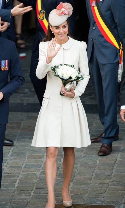 Attending a special ceremony and reception at the Grand Place in Mons, Germany, Kate proved her sartorial prowess in a stunning cream coat dress with a pleated skirt by Alexander McQueen. She topped her neutral look off with a matching Jane Taylor hat featuring dusty-pink roses and, of course, her favorite L.K. Bennett heels. 