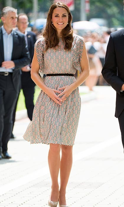 That's not a dress Kate's wearing! The Duchess changed things up in a matching skirt and top from Singapore-based designer RAOUL. The style icon kept it casual for an appearance at a cultural event in Queenstown, Singapore on the Diamond Jubilee tour in 2012.