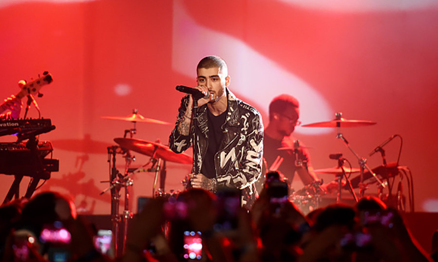 March 26: Mind of Zayn! Zayn Malik performed for the crowd including girlfriend Gigi Hadid at the IHeartRadio theatre in NYC during his <i>Mind of Mine</i> album release party.