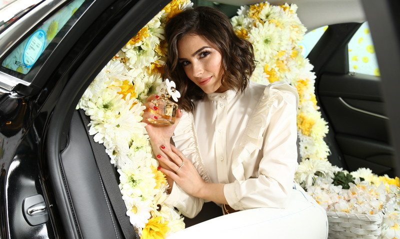 March 26: Flower power! Olivia Culpo took a drive in the Daisy Marc Jacobs Uber car around NYC.