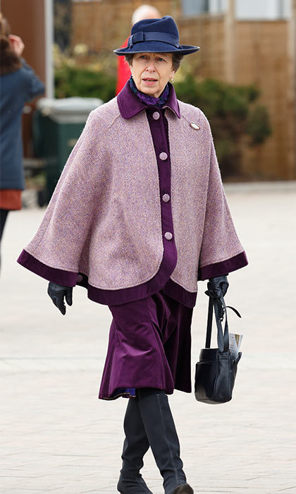 Queen Elizabeth's only daughter Princess Anne stepped out in a fedora and bold purple cape for a chilly day at the races. 