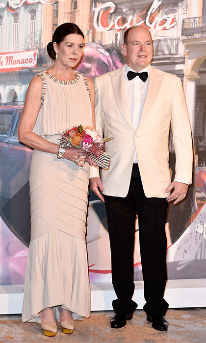 A dapper Prince Albert of Monaco accompanied his sister Princess Caroline of Hanover, wearing Chanel, to the annual Rose Ball.