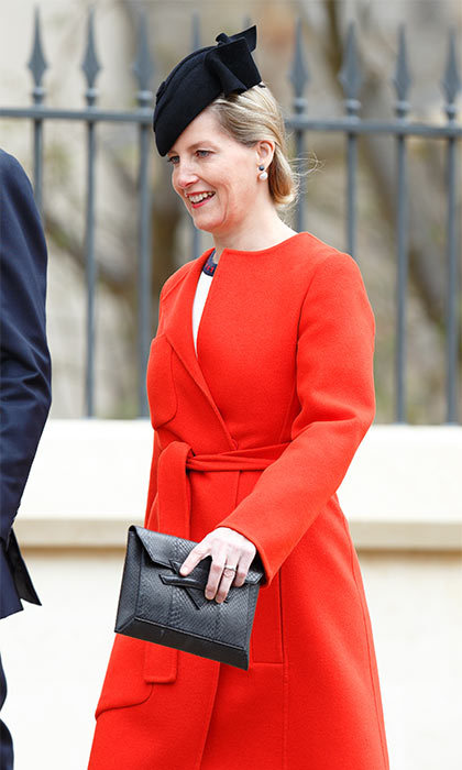 A pop of color: Sophie, Countess of Wessex looked great in a bright scarlet wool coat and a black felt fascinator. 