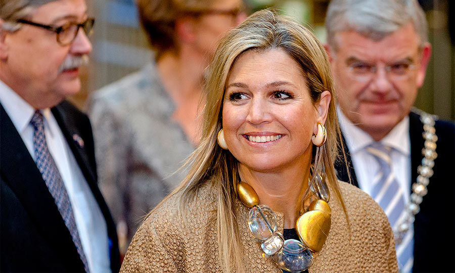 The mom-of-three showed us you can never have too many big accessories! Maxima rocked large cream earrings with a statement stone necklace during a royal engagement in Utrecht.