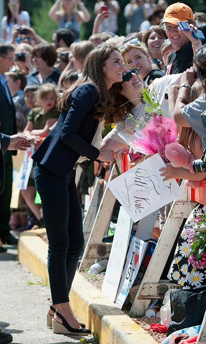The Duchess of Cambridge has become a selfie queen thanks to the hundreds of photos she's posed in. Here she snaps a picture with a well-wisher in Alberta, Canada.