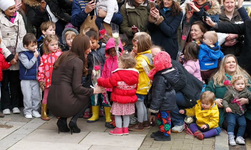 Before departing the Fostering Network headquarters in London, Kate spoke to little ones who had lined up to give her flowers. 